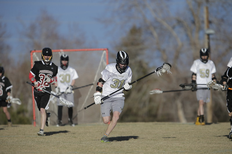 JPM0186-JPM0186-Jonathan first HS lacrosse game March 9th.jpg