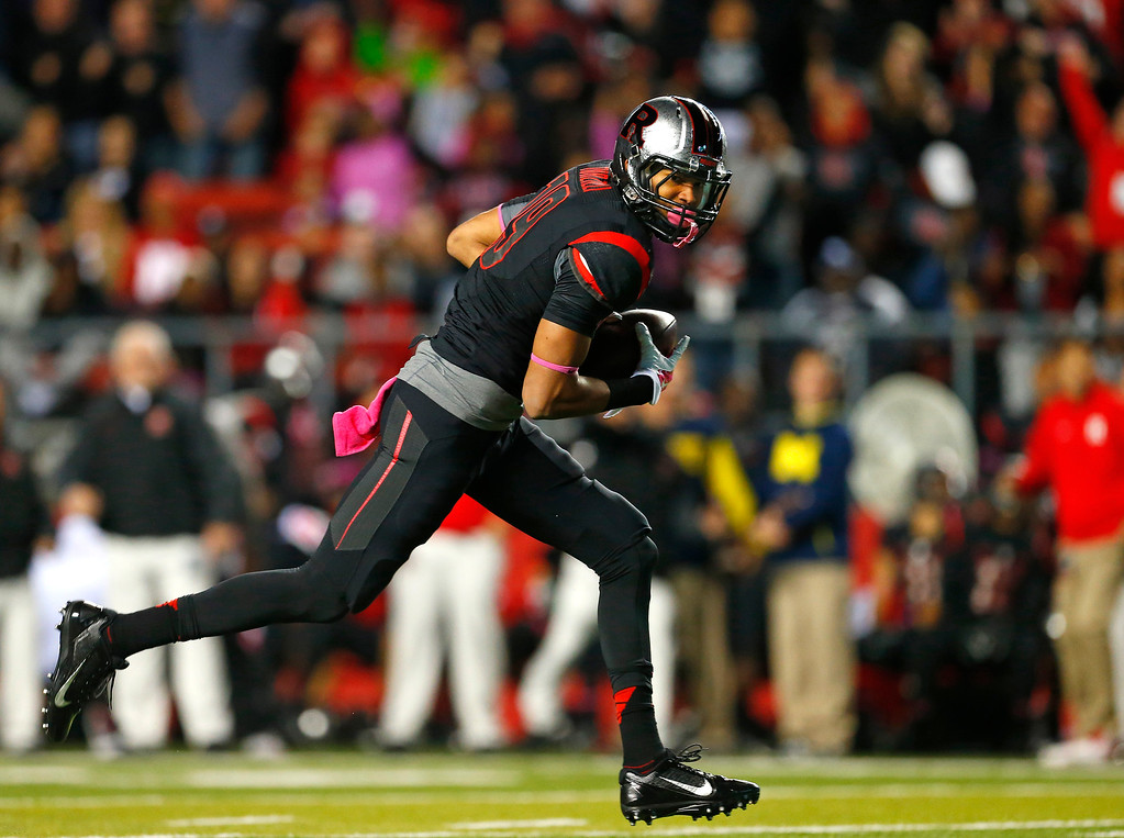 . Rutgers wide receiver Andrew Turzilli runs on the way to a touchdown reception against Michigan during the first half of an NCAA college football game Saturday, Oct. 4, 2014, in Piscataway, N.J. (AP Photo/Rich Schultz)