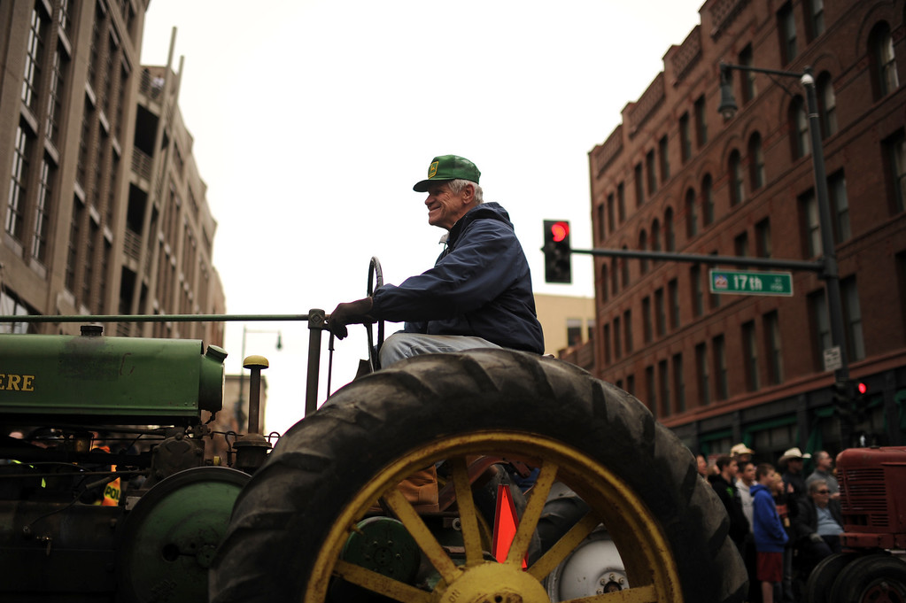 . Allen Wuff is driving the tractor during 107th National Western Stock Show Kick-Off Parade at Downtown Denver on Thursday, Denver, CO, January 10, 2013.  Hyoung Chang, The Denver Post