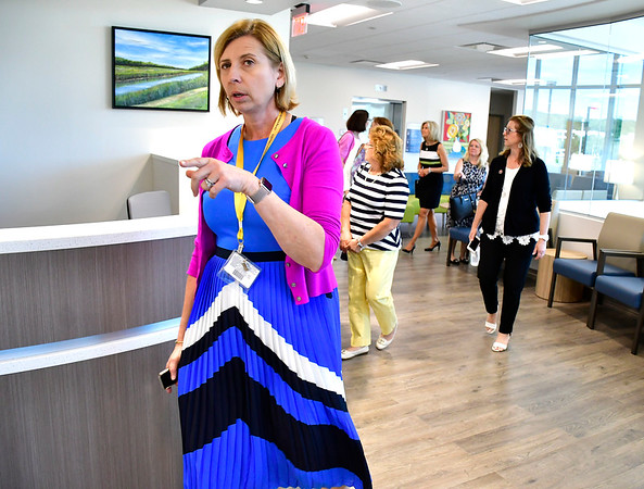 6/7/2019 Mike Orazzi | Staff Dagmara Scalise gives tours inside Bristol Health's new downtown building on Friday.