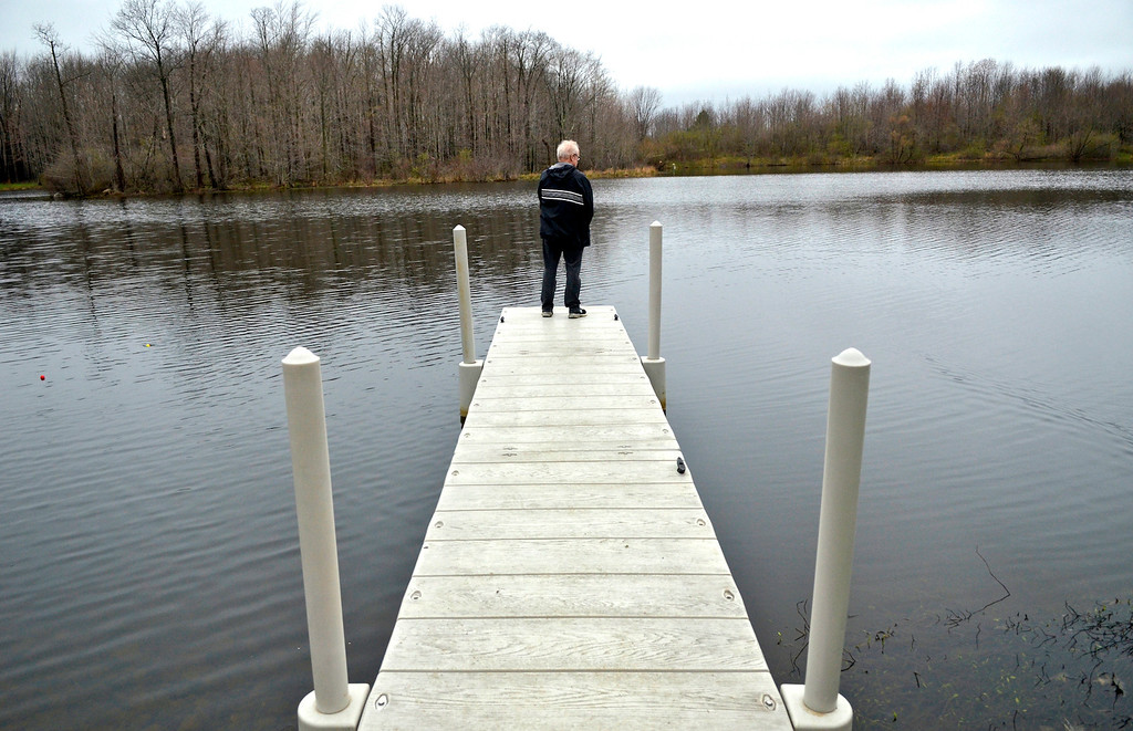. Jeff Forman/JForman@News-Herald.com Volunteer Chris Braden fishes from the pier during the Lake Metroparks Fantastic Fishing program for people with disabilities April 30 at Hidden Lake in Leroy Township.