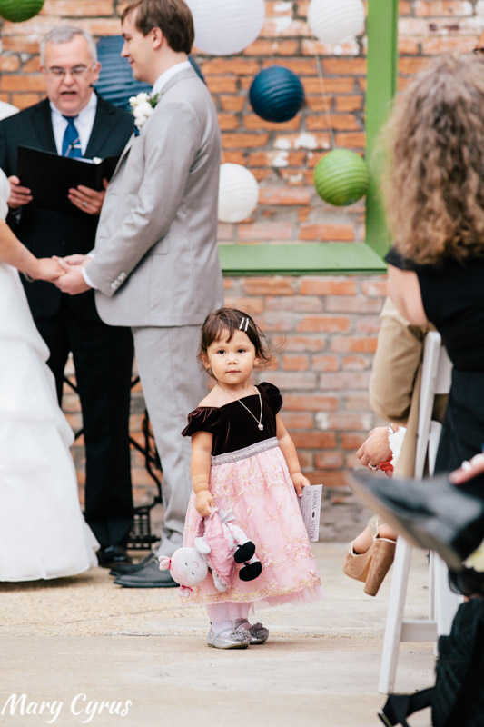 A little girl wandering into the aisle at Matt & Larissa's McKinney Cotton Mill wedding | Photo by Mary Cyrus Photography - Weddings & Portraits in Dallas & Beyond