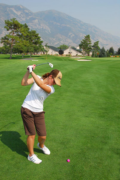 8/2/07 – Jessica and I continue to have fun playing golf. She is hitting her final shot into the 9th green with the clubhouse in the background.