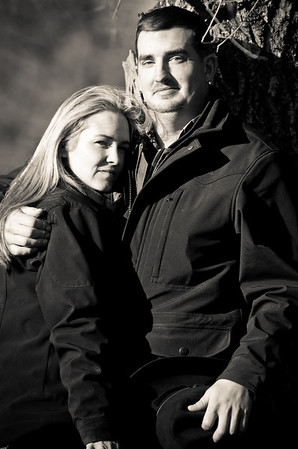 Couple at at ranch during winter outdoor engagement photos near Severson Dells in Rockford, IL