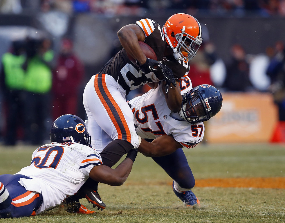 . Running back Edwin Baker #27 of the Cleveland Browns runs the ball as he is hit by linebackers James Anderson #50 and Jonathan Bostic #57 of the Chicago Bears at FirstEnergy Stadium on December 15, 2013 in Cleveland, Ohio.  (Photo by Matt Sullivan/Getty Images)
