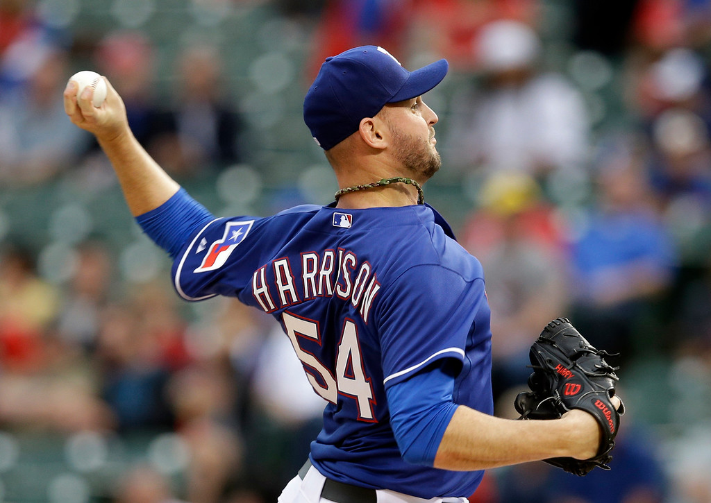 . Texas Rangers starting pitcher Matt Harrison (54) works against the Colorado Rockies in the second inning of a baseball game, Thursday, May 8, 2014, in Arlington, Texas. (AP Photo/Tony Gutierrez)