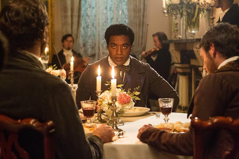 ". Chiwetel Ejifor, center, is Solomon Northrup in ""12 Years a Slave.\"" Provided by Fox Searchlight."