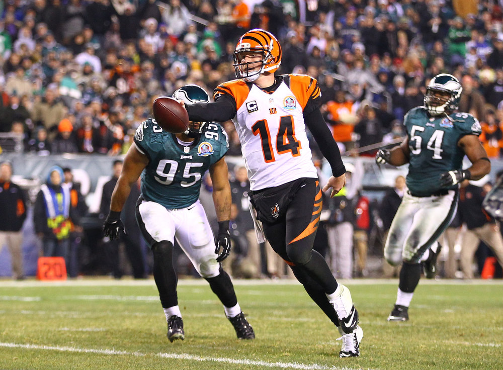 . Andy Dalton #14 of the Cincinnati Bengals runs for a touchdown during their game against the Philadelphia Eagles at Lincoln Financial Field on December 13, 2012 in Philadelphia, Pennsylvania.  (Photo by Al Bello/Getty Images)