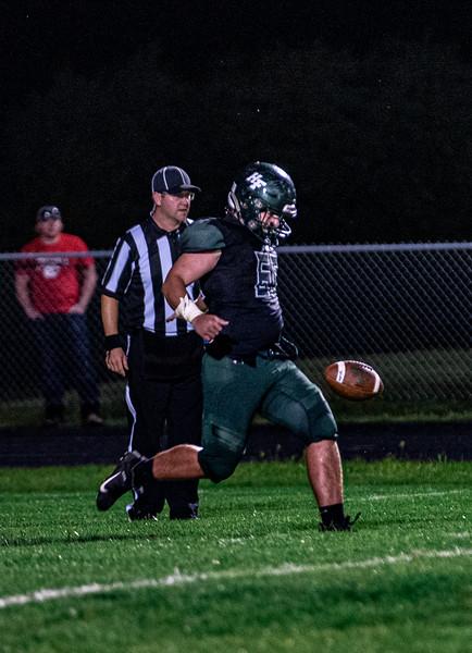 Holy Family Varsity Football vs. Mound Westonka, 8/29/19: Captain Mark Roane '20 (65)