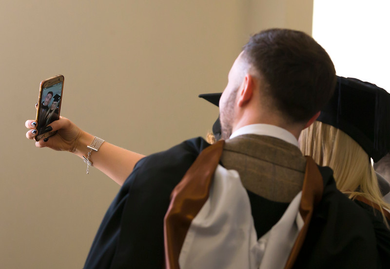 02/11/2017. FREE TO USE IMAGE. WIT (Waterford Institute of Technology) Conferring, Waterford City are Business Graduates take a selfie as they get in line for the conferring. Picture: Patrick Browne