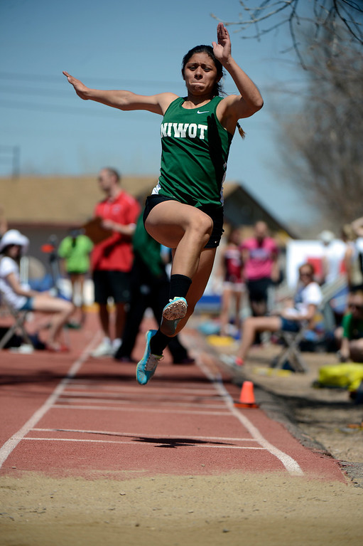 . LITTLETON, CO. - APRIL 27TH: Deyja Enriquez, launches in the girls triple jump competition during the Liberty Bell Track Meet at Littleton Public Schools Stadium Saturday, April 27th, 2013. (Photo By Andy Cross/The Denver Post)