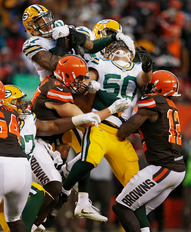 . Green Bay Packers strong safety Josh Jones, top left, catches an interception in the second half of an NFL football game against the Cleveland Browns, Sunday, Dec. 10, 2017, in Cleveland. (AP Photo/Ron Schwane)
