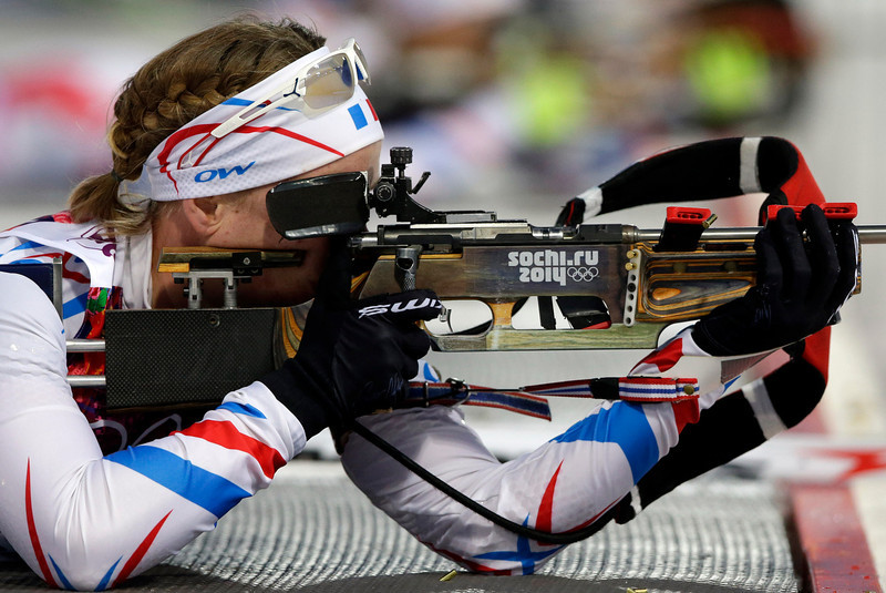 . France\'s Anais Bescond shoots during the women\'s biathlon 15k individual race, at the 2014 Winter Olympics, Friday, Feb. 14, 2014, in Krasnaya Polyana, Russia. (AP Photo/Lee Jin-man)