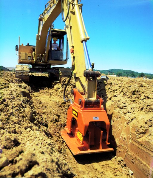 NPK C6C compactor on Cat excavator-trenching (1).JPG