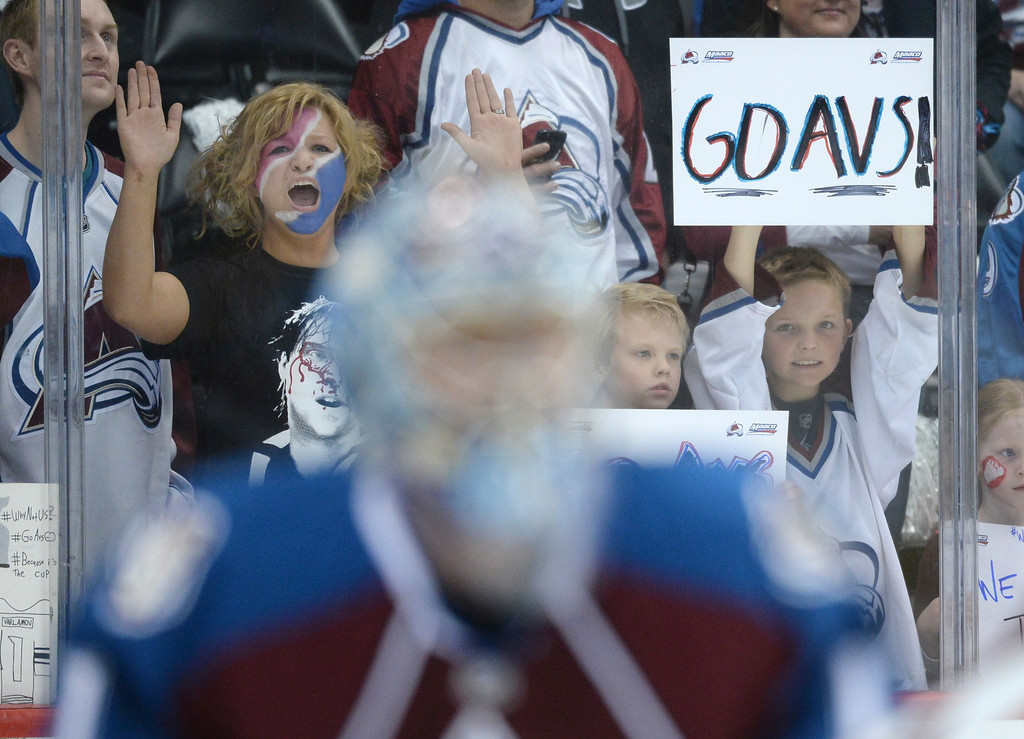 . DENVER, CO - APRIL 24: Colorado fans cheered as the Avs took the ice Saturday night. The Colorado Avalanche hosted the Minnesota Wild in the fifth game of a playoff series Saturday night, April 26, 2014. (Photo by Karl Gehring/The Denver Post)