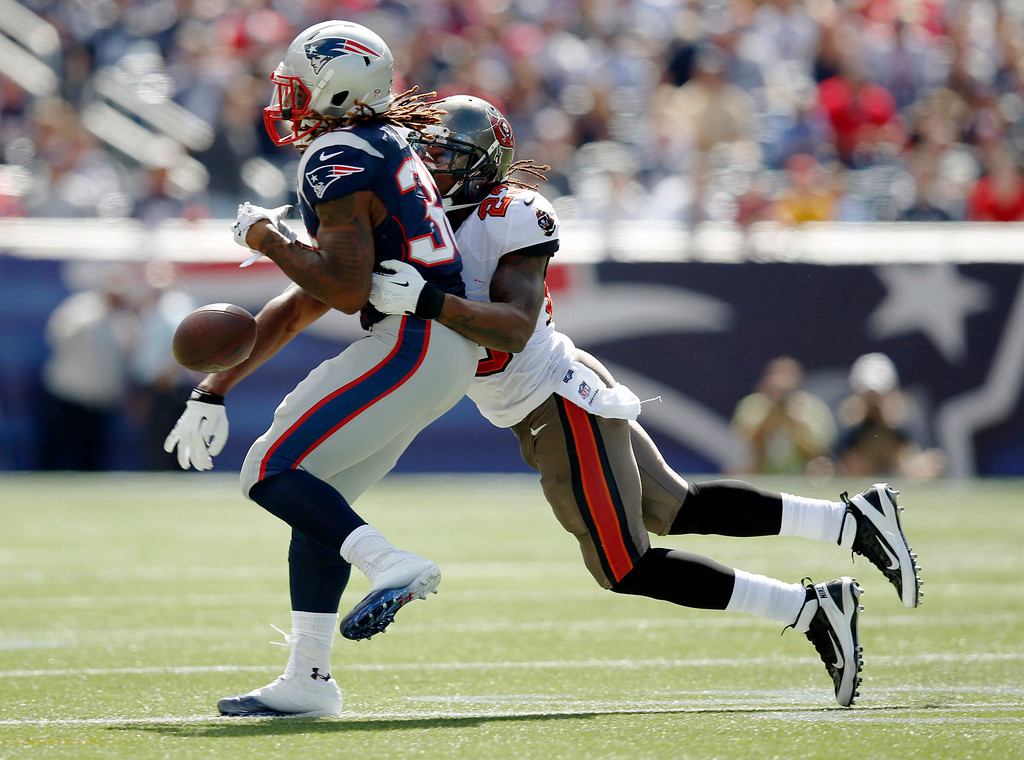 . Tampa Bay Buccaneers strong safety Mark Barron (23) breaks up a pass intended for New England Patriots running back Brandon Bolden (38) in the first half of an NFL football game Sunday, Sept. 22, 2013, in Foxborough, Mass. (AP Photo/Elise Amendola)