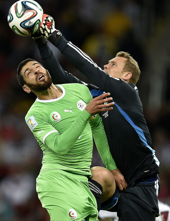 . Algeria\'s defender Rafik Halliche (L) vies with Germany\'s goalkeeper Manuel Neuer during a Round of 16 football match between Germany and Algeria at Beira-Rio Stadium in Porto Alegre during the 2014 FIFA World Cup on June 30, 2014. Lucas Uebel/AFP/Getty Images