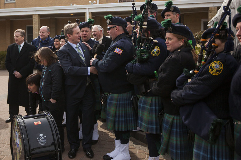. Irish Prime Minister Enda Kenny (L) meets members of the Breezy Point Catholic Club Pipes & Drums after attending Saint Patrick\'s Day Mass at St. Thomas More Church on March 17, 2013 in the Breezy Point neighborhood in the Queens borough of New York City. Breezy Point, home to many residents with Irish ancestry, was devastated by Superstorm Sandy in October 2012.  (Photo by Michael Nagle/Getty Images)