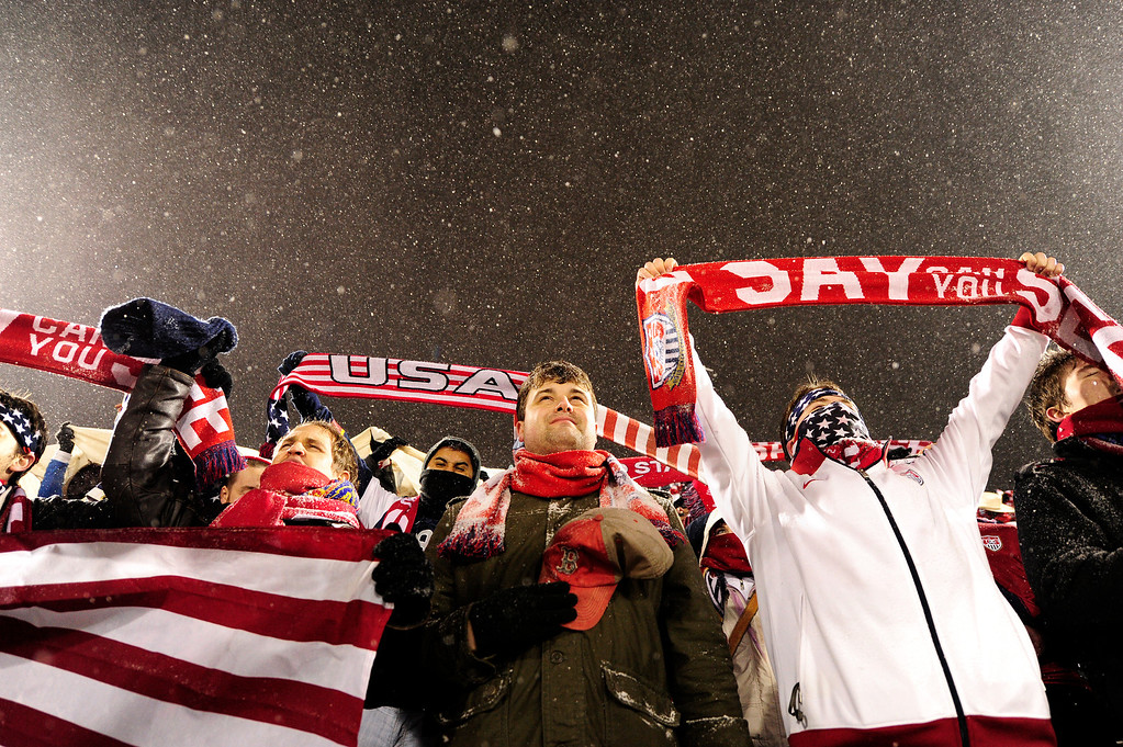 . COMMERCE CITY, CO - MARCH 22: John Duval, of Adams, Massachusetts, center, holds his hat over his heart during the National Anthem before a FIFA 2014 World Cup Qualifier at Dick\'s Sporting Goods Park between the United States and Costa Rica on March 22, 2013, in Commerce City, Colorado. (Photo by Daniel Petty/The Denver Post)