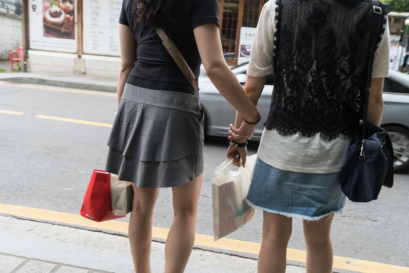 There's a lot of platonic hand-holding in Seoul. Friends, whether male or female will hold hands, even though they're not romantically involved. It's sweet, and I wanted to capture it.