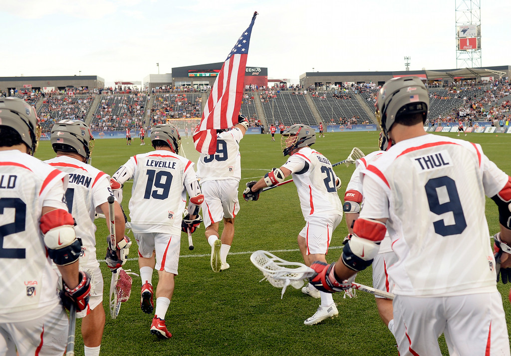 . American midfielder Paul Rabil led the squad onto the field Thursday night. The United States took on Canada in the opening game of the FIL World Lacrosse Championships Thursday night, July 10, 2014.   Photo by Karl Gehring/The Denver Post