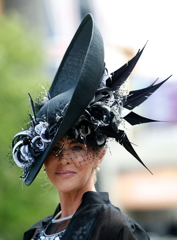 . Milnda Strudwick wears an ornate hat on the first day of the Royal Ascot horse racing meeting at Ascot, England, Tuesday, June, 17, 2014. Royal Ascot the annual five day horse race meeting that Britain\'s Queen Elizabeth II attends every day was started in 1711 under Queen Anne, with the first four day meeting starting in 1768. (AP Photo/Alastair Grant)