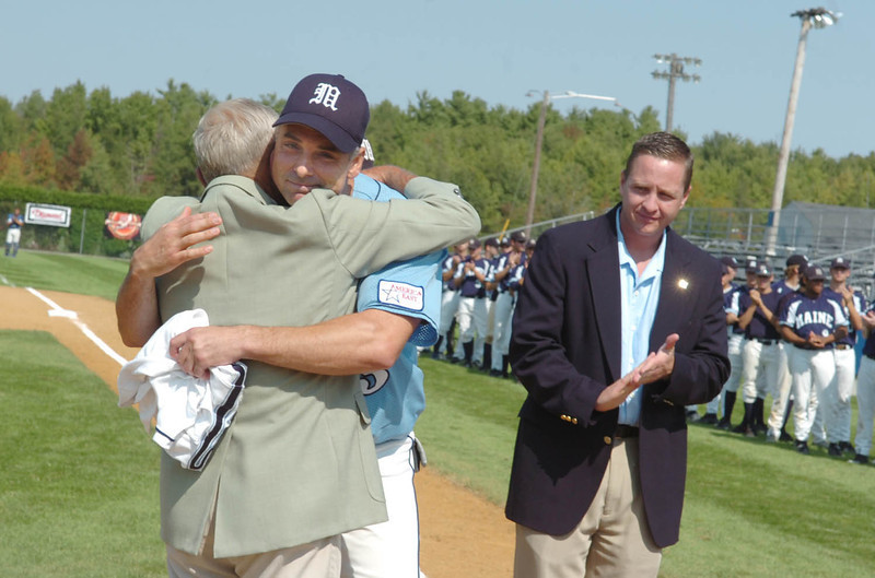 Mike Bordick hugs former University of Maine baseball coach John Winkin at Saturday's ceremony during which UMaine retired Bordick's No. 3 jersey.  Bordick went on to play 14 seasons in the major leagues. (BANGOR DAILY NEWS PHOTO BY KATE COLLINS)