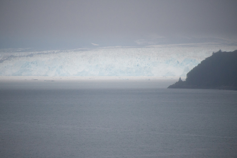 The left face of the glacier appears through the morning fog.