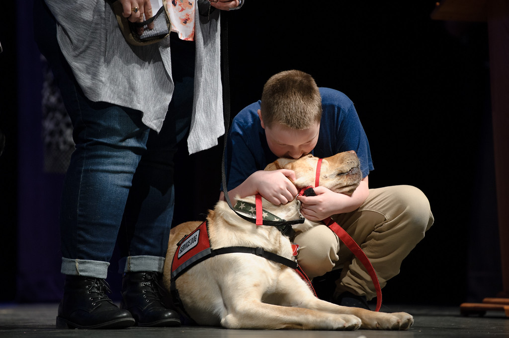 . NEADS graduates Benjamin Van Ryn and his social dog Brody have a moment on stage just before receiving their diploma on Sunday April 9, 2017 at Montachusett Regional Vocational Technical School in Fitchburg.  (Sentinel & Enterprise photo/Jeff Porter)