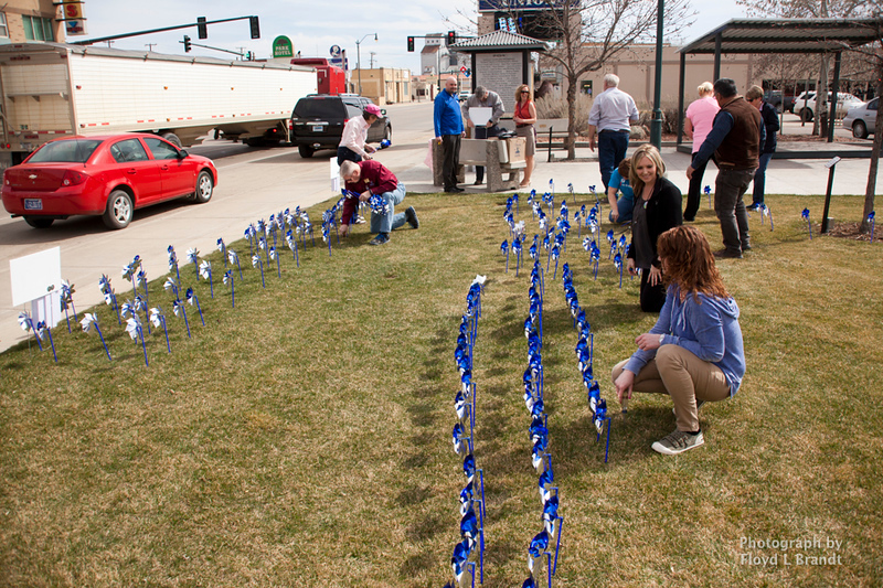 Havre Daily News/Floyd BrandtCASA members met in Town Square to plant pinwheels Thursday. Each pinwheel represents a child that CASA has intervended for. There are 211 pinwheels planted in the square. Executive Director Mark Douglas said that he was glad that the number not any higher.