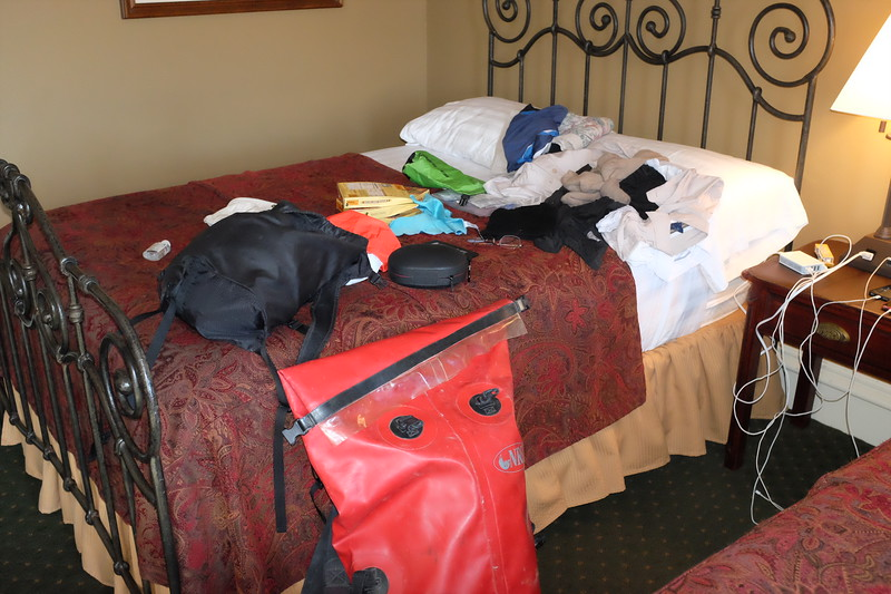 The large, red bag is completely waterproof, and earmarked for one's sleeping bag, and other items needed only while in camp. Close-at-hand items went in a smaller yellow bag of the same design.