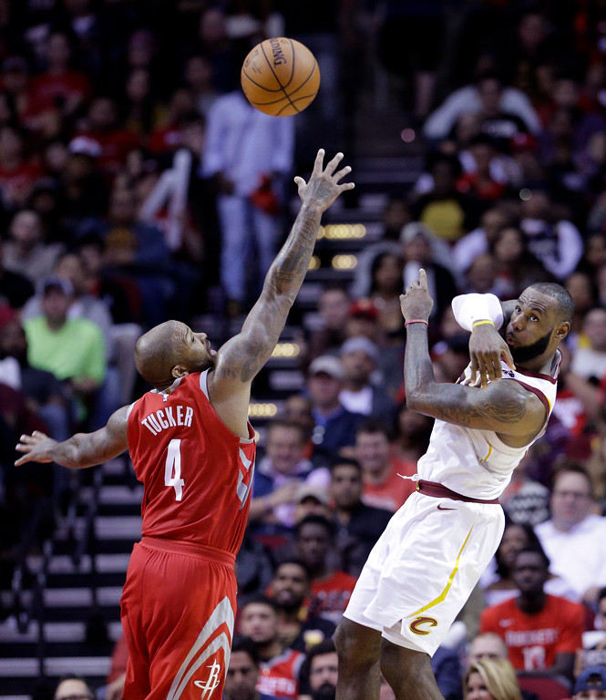 . Houston Rockets forward PJ Tucker (4) tries to block the pass by Cleveland Cavaliers forward LeBron James (23) during the second half of an NBA basketball game Thursday, Nov. 9, 2017, in Houston. (AP Photo/Michael Wyke)