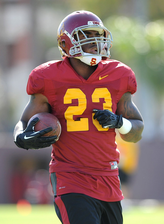 . USC\'s Tre Madden carries the ball during spring practice at USC Monday, April 1, 2014. (Andy Holzman/Los Angeles Daily News)