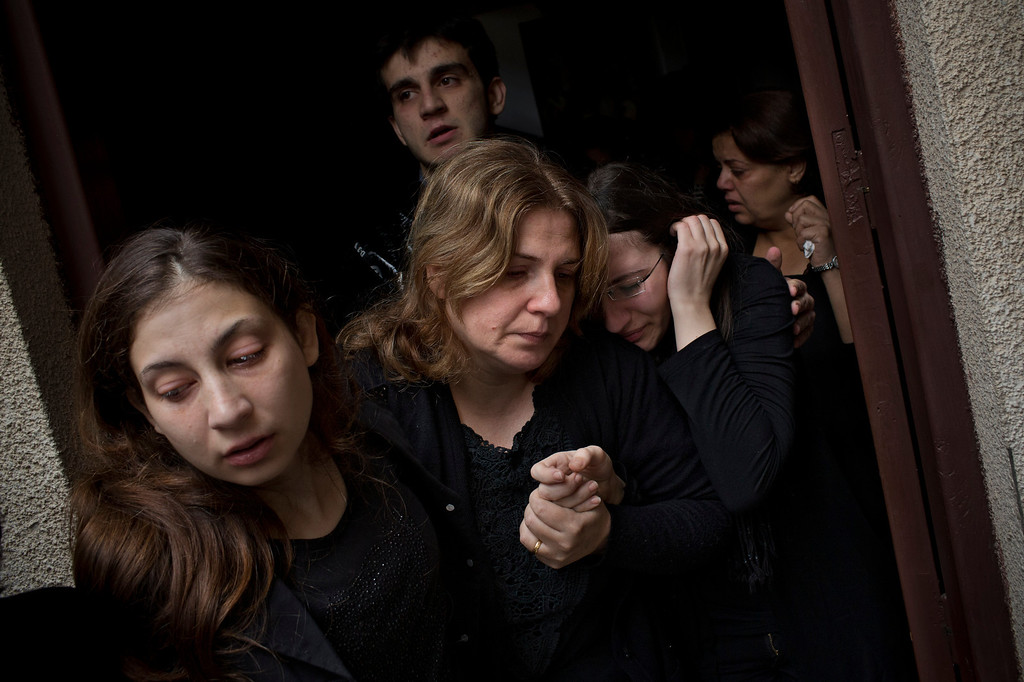 . In this Nov. 20, 2012 file photo, Palestinian mourners cry during the funeral of Salem Paul Sweliem during his funeral in Gaza City. This photo was one in a series of images by Associated Press photographer Bernat Armangue that won the first place prize in the World Press Photo 2013 photo contest for the Spot News series category.   (AP Photo/Bernat Armangue, File)