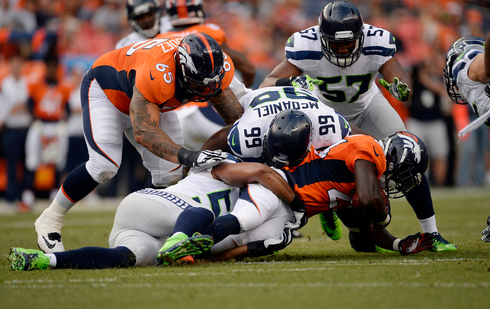 . Running back Ronnie Hillman (23) of the Denver Broncos gains a yard during the first quarter of the game.  The Denver Broncos vs the Seattle Seahawks At Sports Authority Field at Mile High. (Photo by AAron Ontiveroz/The Denver Post)