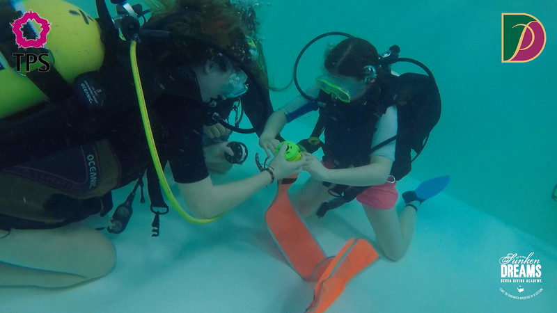 DPS Divemasters in Training.00_00_18_02.Still070.jpg