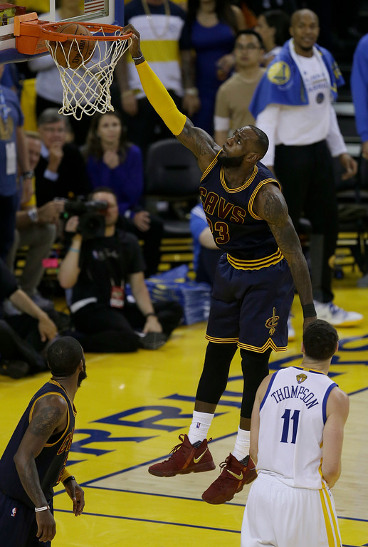 . Cleveland Cavaliers forward LeBron James (23) dunks against the Golden State Warriors during the second half of Game 1 of basketball\'s NBA Finals in Oakland, Calif., Thursday, June 1, 2017. (AP Photo/Ben Margot)