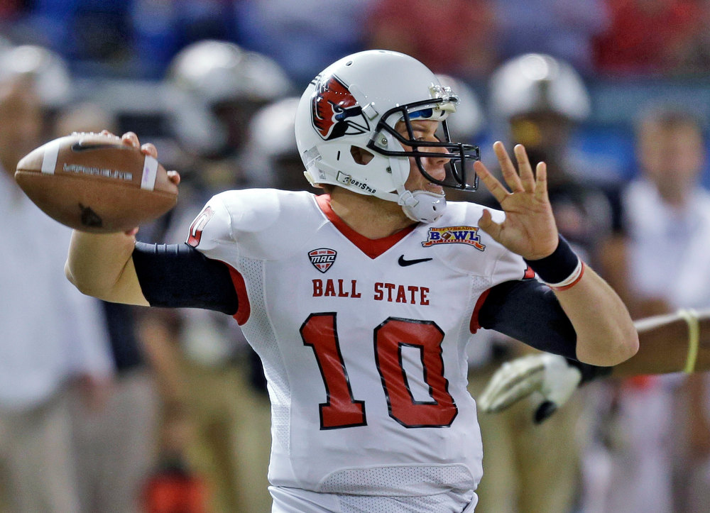 Description of . Ball State quarterback Keith Wenning throws a pass against Central Florida during the first quarter of the Beef 'O' Brady's Bowl NCAA college football game Friday, Dec. 21, 2012, in St Petersburg, Fla. (AP Photo/Chris O'Meara)