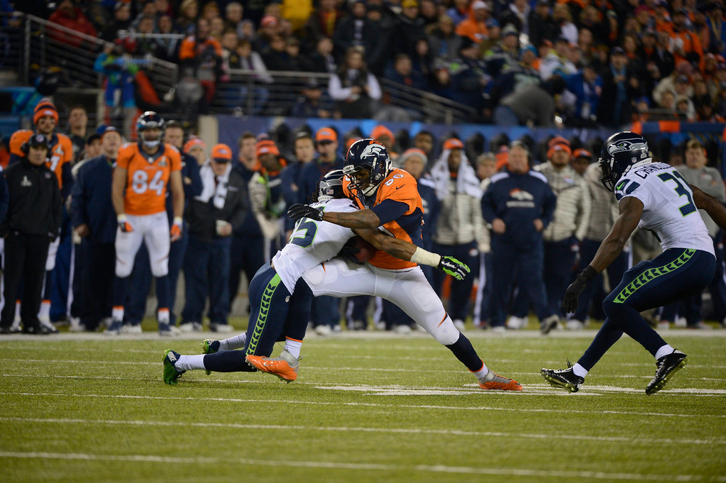 . Denver Broncos tight end Julius Thomas (80) tries for an extra yard during the second quarter. The Denver Broncos vs the Seattle Seahawks in Super Bowl XLVIII at MetLife Stadium in East Rutherford, New Jersey Sunday, February 2, 2014. (Photo by Joe Amon/The Denver Post)