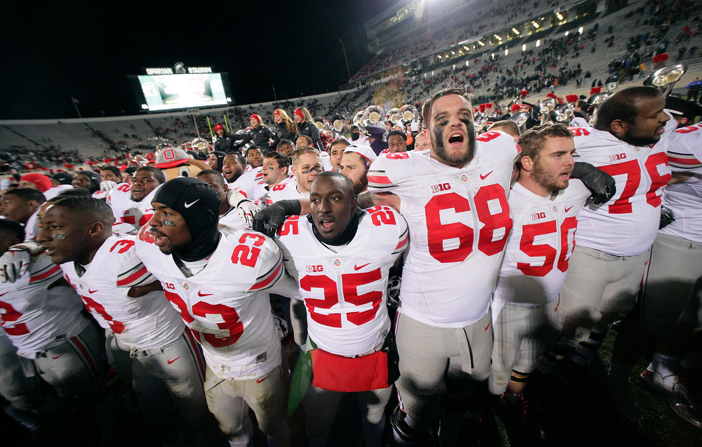 . Ohio State players celebrate following their 49-37 win over Michigan State in an NCAA college football game, Saturday, Nov. 8, 2014, in East Lansing, Mich. (AP Photo/Al Goldis)