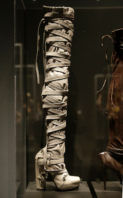 ". A thigh-high boot designed by Nicholas Kirkwood for the Rodarte Spring 2009 fashion show at the ""Shoe Obsession\"" exhibit at The Museum at the Fashion Institute of Technology Museum in New York. The exhibition, showing off 153 specimens, runs through April 13. (AP Photo/Kathy Willens)"
