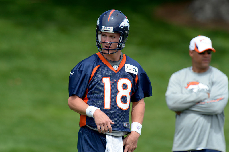 . Peyton Manning (18) of the Denver Broncos runs drills during drills at mini camp June 12, 2013 at Dove Valley. (Photo By John Leyba/The Denver Post)