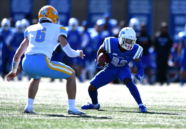 10/26/2019 Mike Orazzi | StaffrCCSU's Kyren Petteway (82) and Long Island University's Caleb Caslow (6) during Saturday's football game in New Britain. r