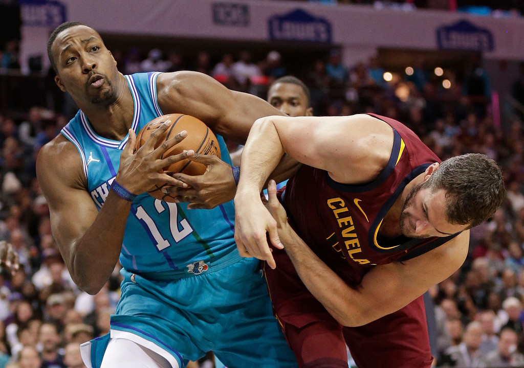 . Charlotte Hornets\' Dwight Howard (12) grabs a rebound from Cleveland Cavaliers\' Kevin Love during the first half of an NBA basketball game in Charlotte, N.C., Wednesday, Nov. 15, 2017. (AP Photo/Chuck Burton)