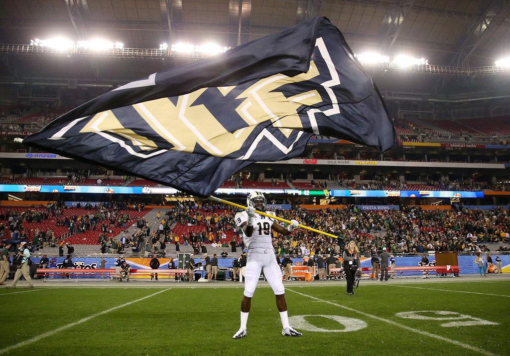 . Wide receiver Josh Reese #19 of the UCF Knights waves a flag on the field after defeating the Baylor Bears 52-42 in the Tostitos Fiesta Bowl at University of Phoenix Stadium on January 1, 2014 in Glendale, Arizona.  (Photo by Ronald Martinez/Getty Images)