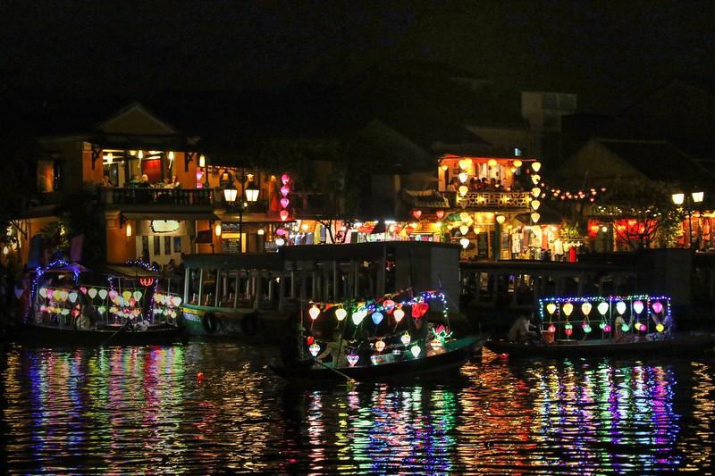 Twinkling lantern boats along the Thu Bon River - Hoi An