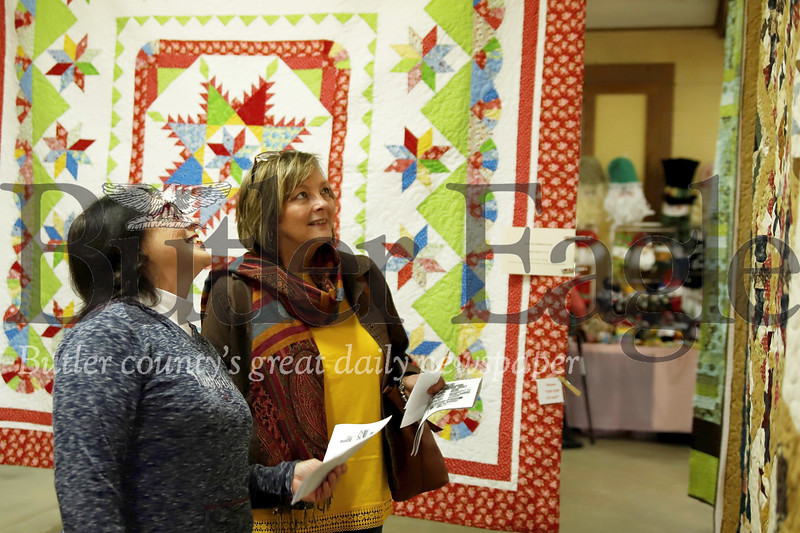 Jean Clyde (left) and Faith Brenneman browse and judge quilts as part of the Quilt Show Saturday. Seb Foltz/Butler Eagle 10/19/19