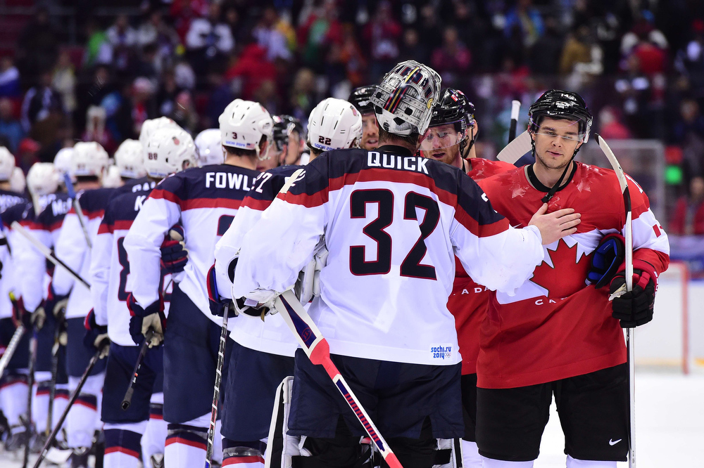 . US player shake hands with Canada\'s players at the end of the Men\'s Ice Hockey Semifinals USA vs Canada at the Bolshoy Ice Dome during the Sochi Winter Olympics on February 21, 2014. Canada won 0-1.   JOHN MACDOUGALL/AFP/Getty Images