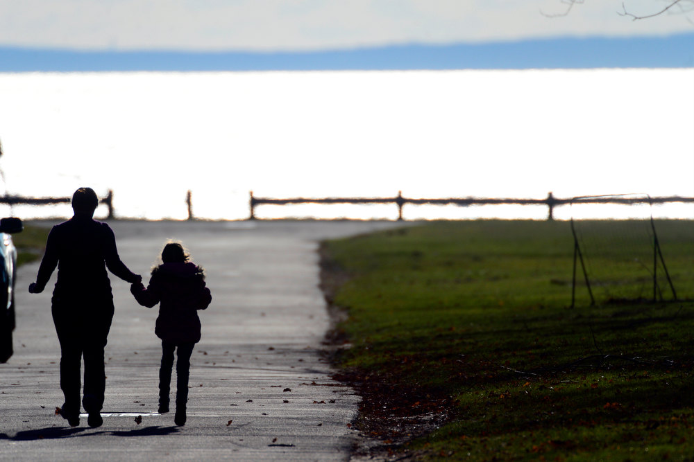 . A woman and child jog down the street during the funeral service for Victoria Soto, 27, at the Lordship Community Church in Stratford, Connecticut on Wednesday, December 19, 2012. Soto, a first grade teacher, was shot and killed during the Newton shooting as she attempted to protect her students against the gunman. AAron Ontiveroz, The Denver Post