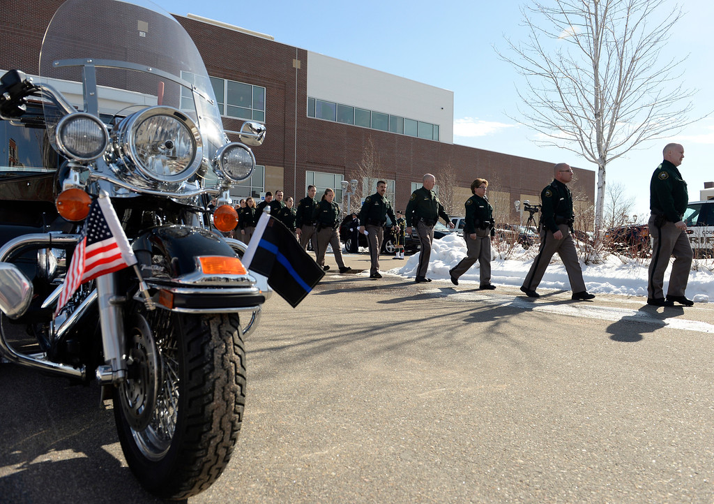 . Police officers from around the state came for the funeral of Sgt. David Baldwin, the Jefferson County Sheriff Deputy, who died Sunday after being hit by a car, February, 03 2014. Baldwin was on motorcycle patrol riding north on Colorado 93 on Sunday morning when he was hit by a vehicle that crossed the double-yellow line. (Photo by RJ Sangosti/The Denver Post)